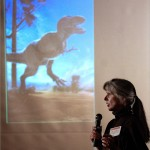 Dr. Mary Schweitzer speaks to a crowd about her dinosaur research at the Raleigh Museum of art. Photo by Marc Hall